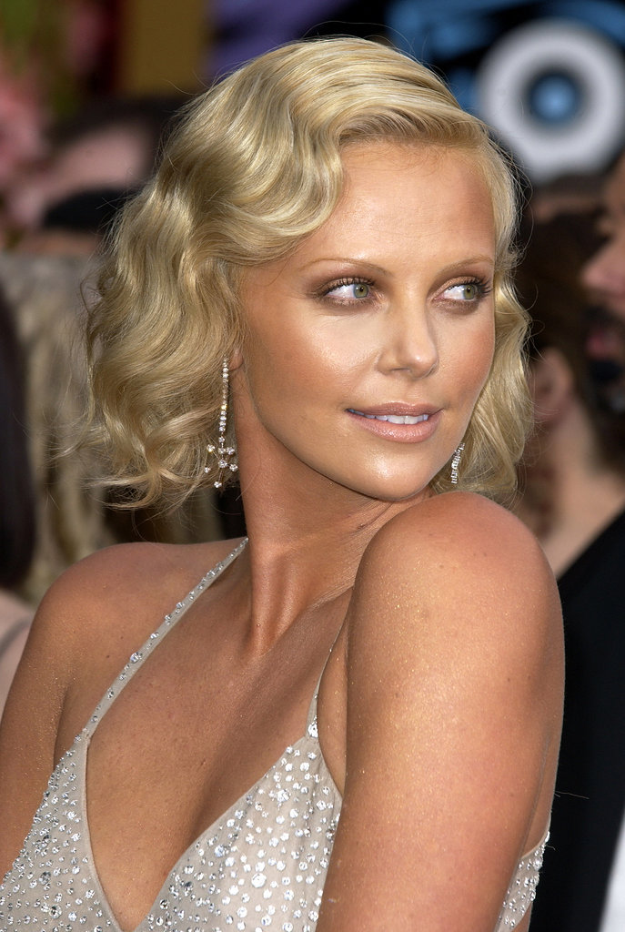 Charlize opted for vintage glamour with chic finger waves and delicate makeup at the 2004 Academy Awards.