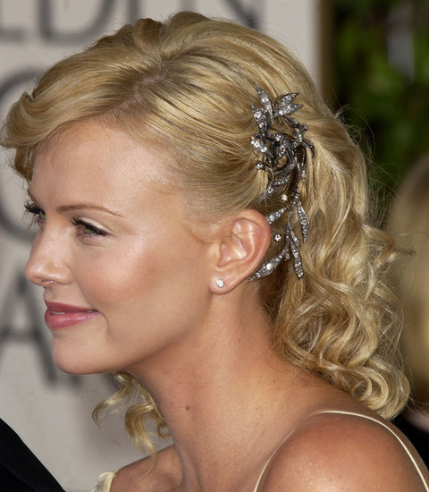 Before scooping up her best actress award for Monster at the 2004 Golden Globes, Charlize stole the show with a gorgeous crystal-and-silver hairpiece.