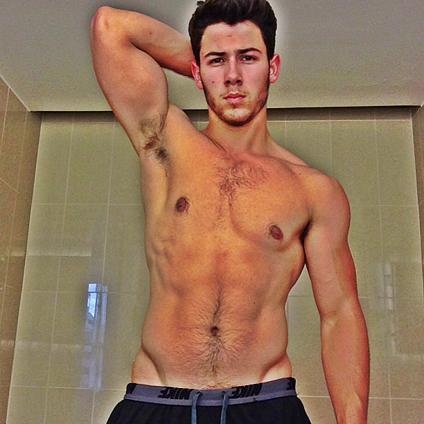 "Nick Jonas shared a shirtless picture with the caption:  ""I never do this but... Healthy living and fitness update. Post workout picture. #diabeticinshape #2.0"" Source: Instagram user nickjonas"