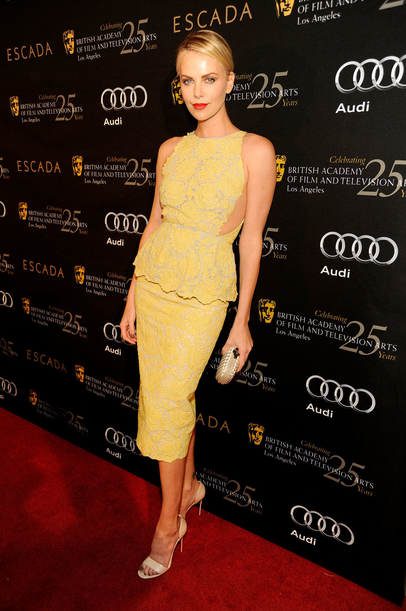 She glowed in this sunny flower-embossed Stella McCartney number — we especially love the added peplum silhouette.