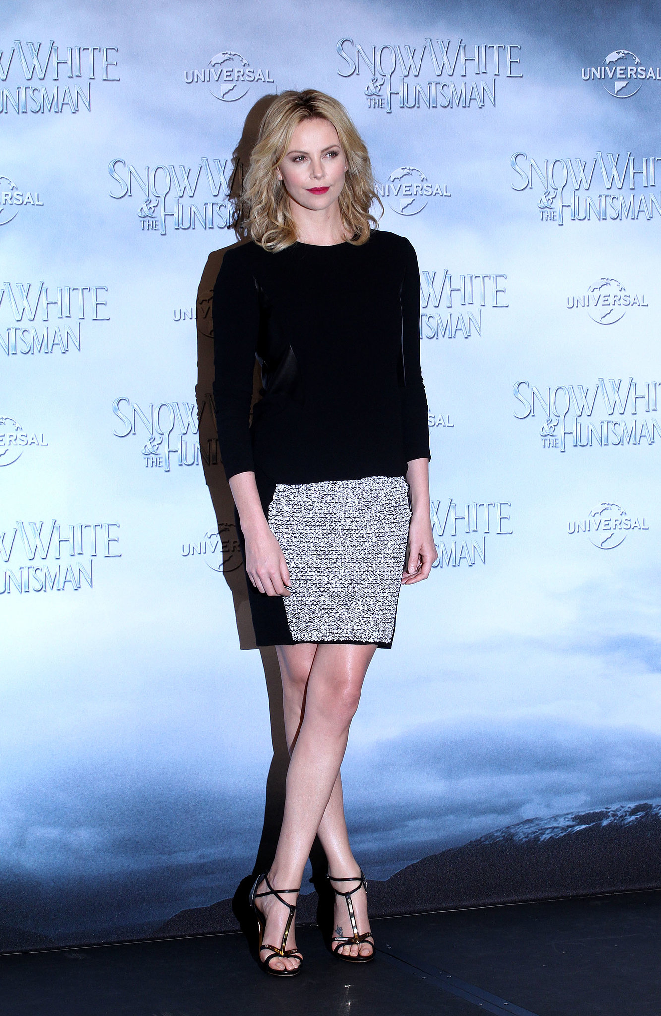 Charlize styled a Rag & Bone knit top with an Alexander