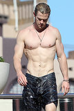 Chris went shirtless for a swim at his Sydney hotel in June 2012.