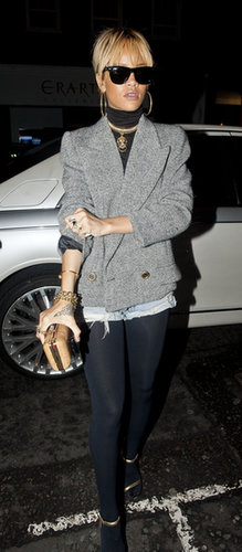 Business on top, party on the bottom. For a 2012 evening out in London, Rihanna layered up in a tweed jacket, a black turtleneck, denim shorts, and thick tights.
