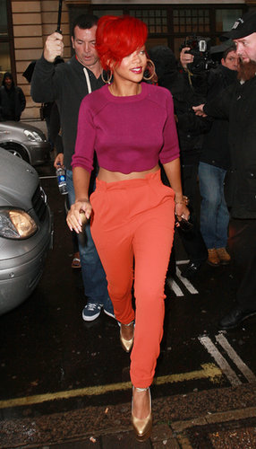 During a 2010 London outing, Rihanna went bold in a cropped fuchsia sweater, sherbet pants, and freshly dyed bright red locks.
