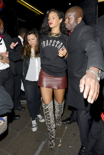 Tom Ford anaconda boots, an oxblood leather mini, and a cozy Trapstar sweater made up Rihanna's 2012 London party style.