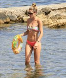 Doutken Kroes was in fine form as she played with her family on the beach in Ibiza on August 5.