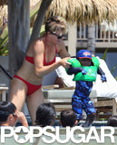 Charlize Theron made sure that Jackson was safely protected with swimming gear.