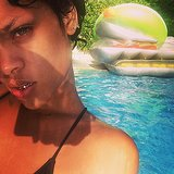 Rihanna showed off her grills while lounging in a pool during her trip to Barbados. Source: Instagram user badgalriri