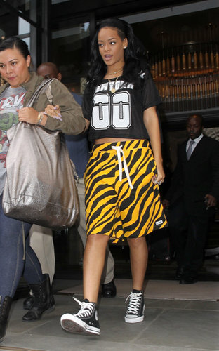 Rihanna was game-day-ready — well, she looked the part at least — styling a cropped Joyrich jersey with animal-print Trukfit shorts and high-top Converse in June 2012.