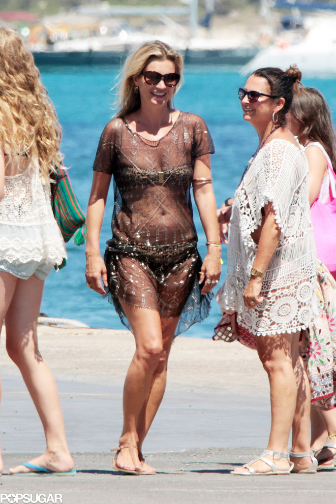 Kate Moss wore a bikini and a see-through coverup on Saturday.
