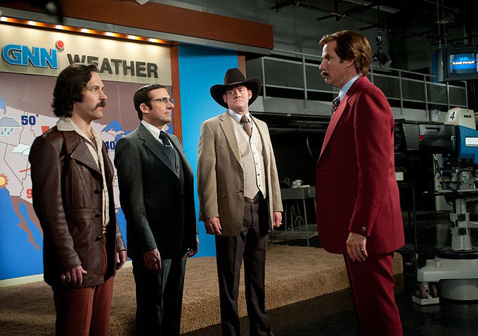 Brian Fantana (Paul Rudd), Brick Tamland (Steve Carell), Champ Kind (David Koechner), and Ron Burgundy (Will Ferrell) assemble for a news team meeting.