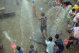 People played around in the water in Baoting, China.