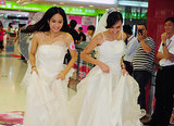 Brides in Guangzhou, China, laughed as they raced in wedding dresses.