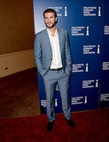 Liam Hemsworth posed on the red carpet at the HFPA Luncheon.