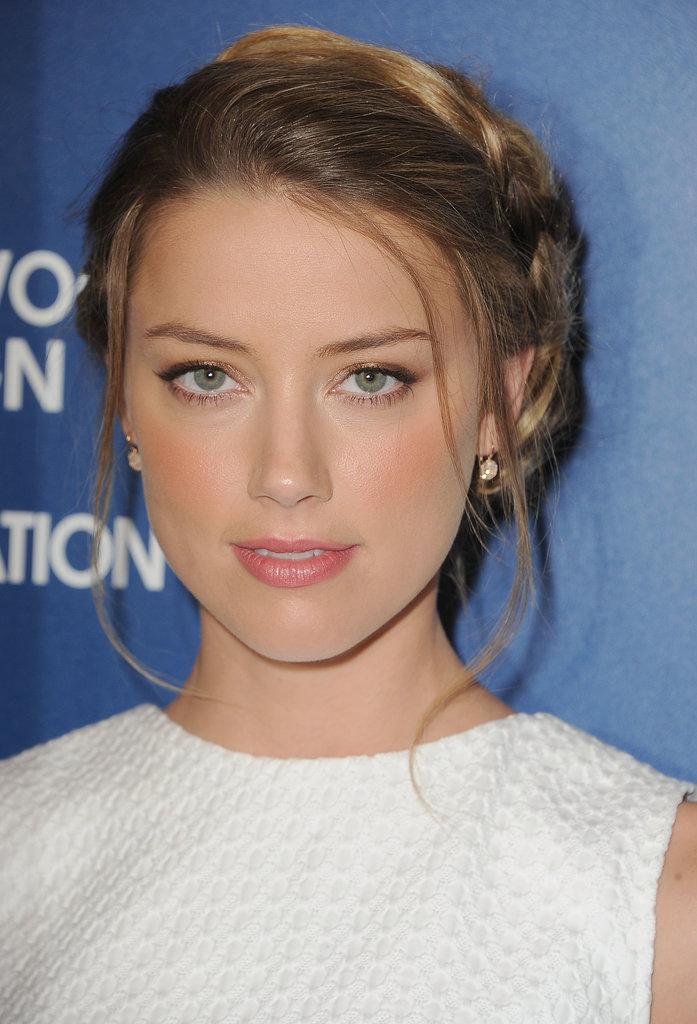 Amber Heard hit the red carpet with a whimsical updo that was comprised of loose braids wrapped into a chignon.