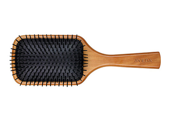 What is a paddle brush good for
