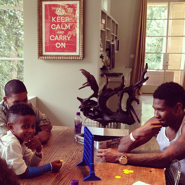 Usher played a game of Connect Four with his son Usher Raymond V once he returned home from the hospital after a pool accident. Source: Instagram user howuseeit