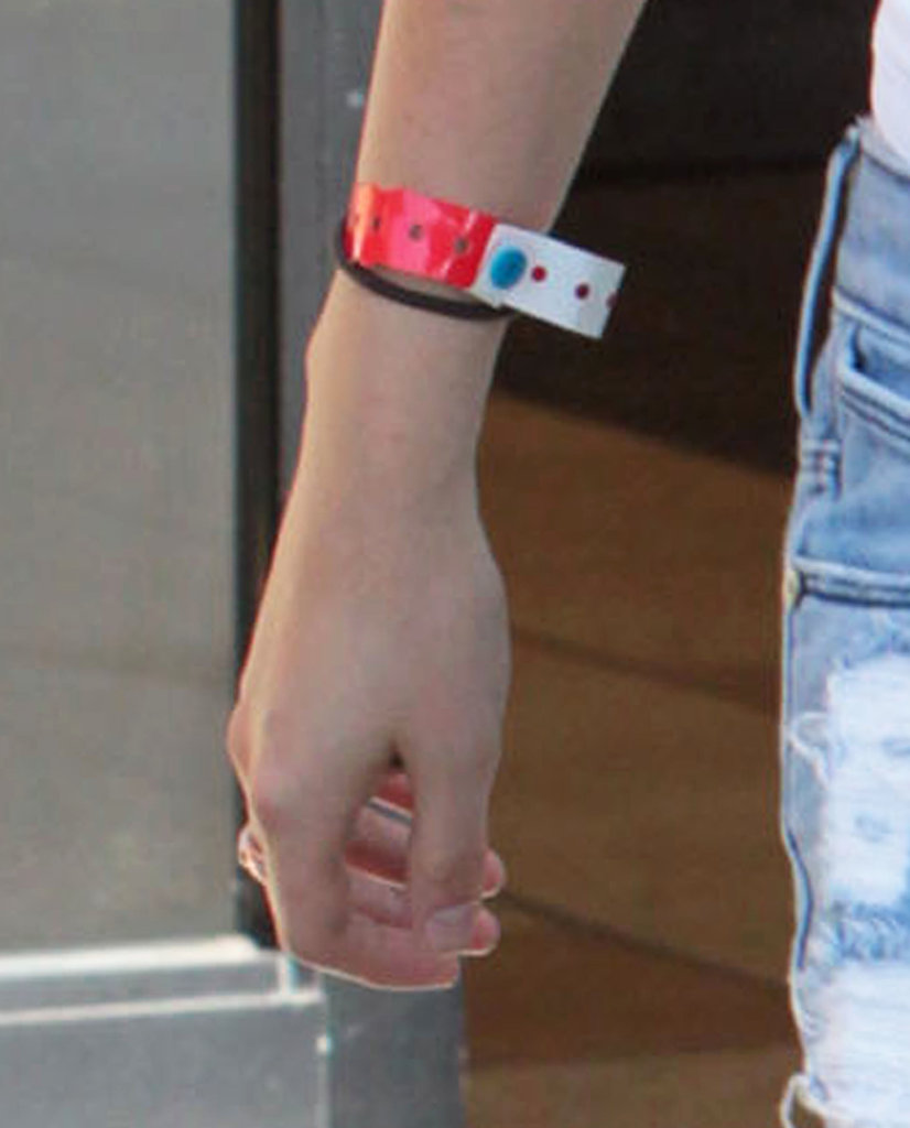 Kristen Stewart showed off a wrist band from a recent event or show.