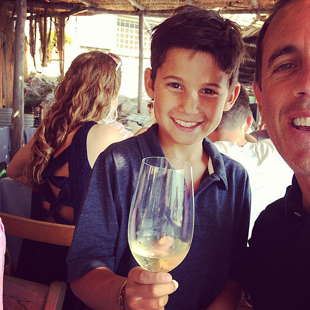 When in Rome? The Seinfelds joked around with a glass of wine during their Italian vacation. Source: Instagram user jessseinfeld