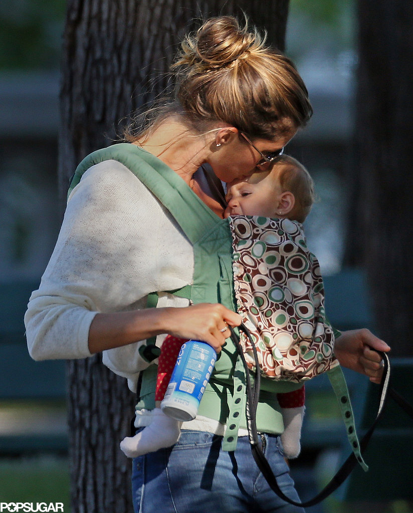 Gisele Bündchen planted a kiss on her baby daughter, Vivian, in Boston.