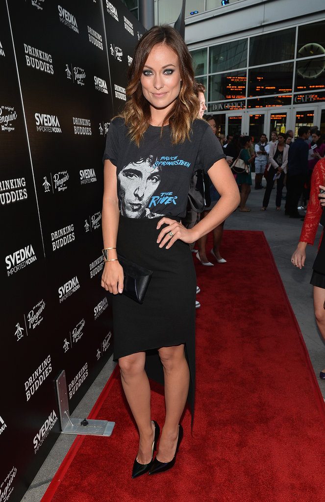 Olivia Wilde rocked a graphic tee and pencil skirt with her Smythson clutch at the Hollywood screening of Drinking Buddies.