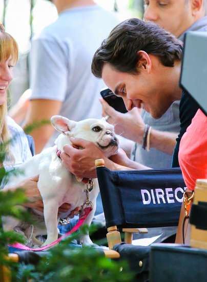 Matt Bomer snuggled with an adorable French bulldog on the set of White Collar in NYC in August 2013.