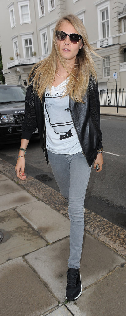 Cara Delevingne makes casual totally cool with a studded leather bomber and sneakers.