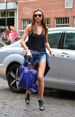 Miranda Kerr's take on the '90s trend is easy and cool with cutoffs, studded booties, and that quintessential shirt wrapped around her waist.