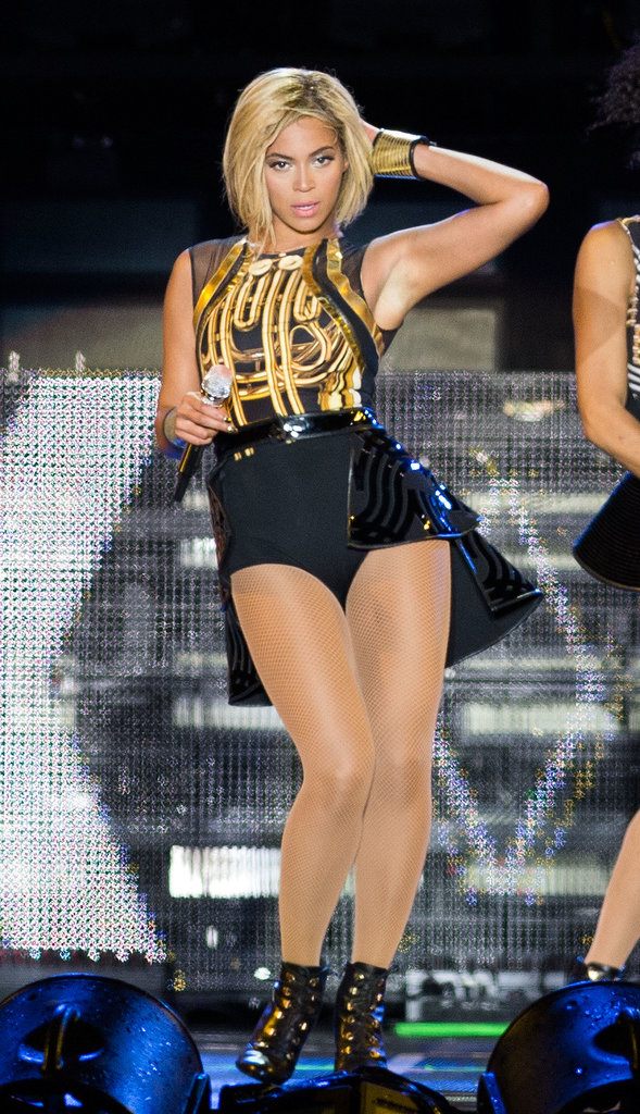 Beyoncé struck a fierce pose in her equally fierce gold and black bodysuit with a tiered asymmetrical skirt.