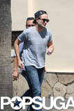 Robert Pattinson wore a gray t-shirt to work.