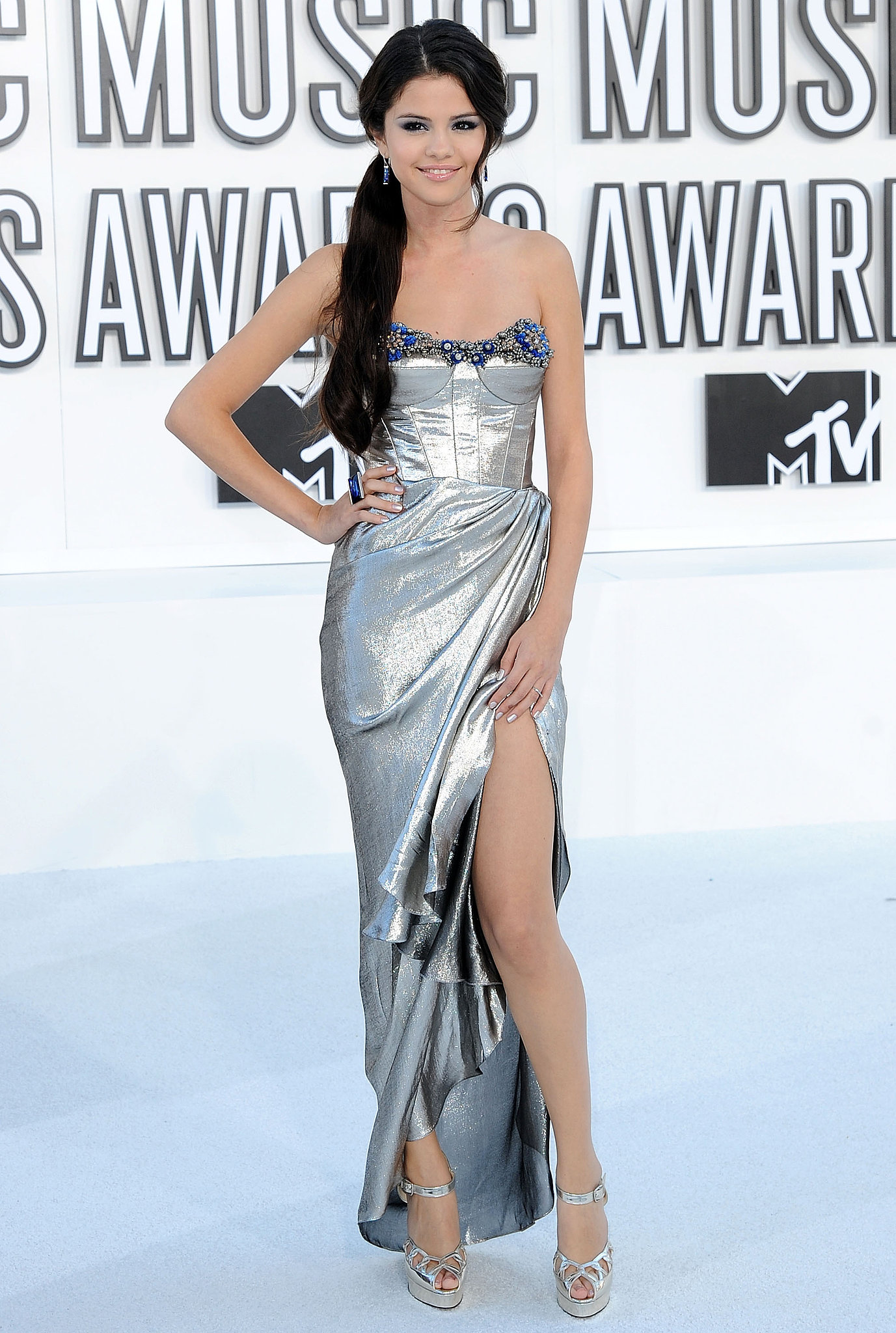 In 2010, Selena Gomez arrived on the carpet in a metallic number.