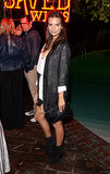 At the Saved Wines launch event, Emily Ratajkowski gave her look a downtown vibe with a relaxed topper and black boots.