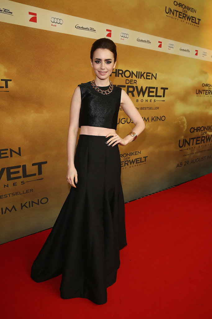 Lily Collins made crop tops a black-tie affair with the help of a full skirt, slicked-back hair, and a gold necklace at the German premiere of The Mortal Instruments: City of Bones.