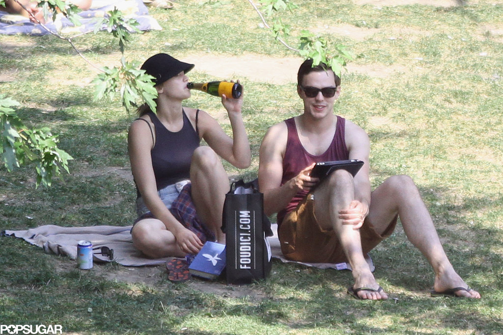 Jennifer Lawrence took a swig of Champagne while at the park.