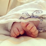 Busy Philipps marveled at baby Cricket's tiny toes wrapped up in an Aden + Anais blanket. Source: Instagram user busyphilipps