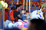 Harper Beckham was all smiles for a ride on a carousel during a trip to Disneyland with her parents, David Beckham and Victoria Beckham, and her brothers.