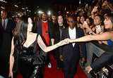Lady Gaga shook a fan's hand while walking the VMAs red carpet.