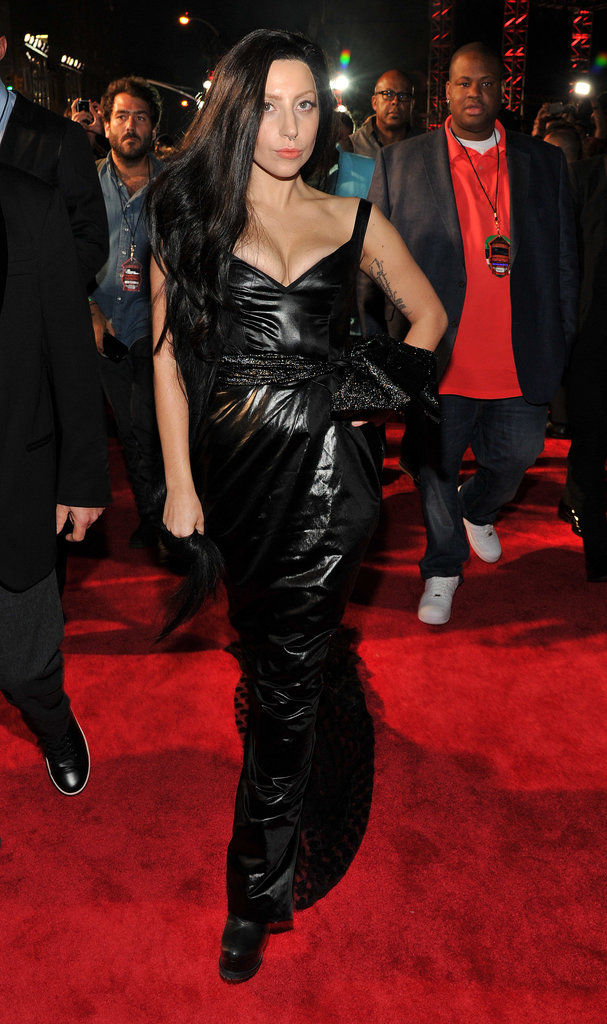 Lady Gaga chose a more subdued route than usual by wearing a custom Prabal Gurung black leather gown and a black wig.