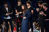 One Direction presented Selena Gomez with the first award of the night.