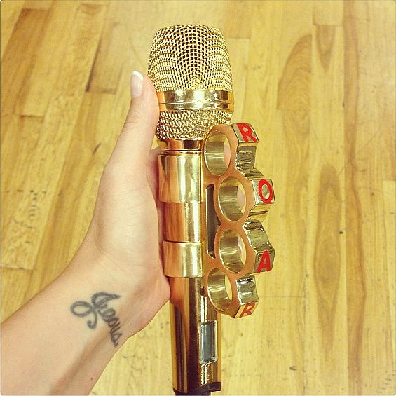 Talk about an accessory — Katy Perry roared into her brass knuckle microphone. Source: Instagram user katyperry
