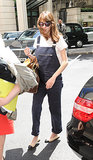 Alexa Chung proves overalls can look totally polished with cap-toe flats.