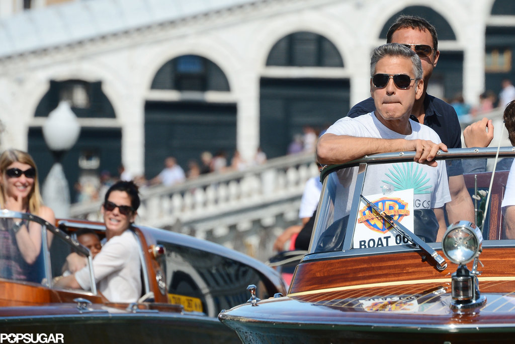 Sandra Bullock and George Clooney rode in side-by-side water taxis in Venice, Italy.