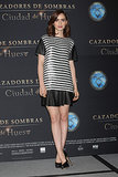 For the Mortal Instruments: City of Bones photocall in Mexico City, Lily Collins mixed stripes, sequins, and leather in a flirty Rachel Zoe top and skirt, then finished with black platform pumps by Brian Atwood and a couple glitzy rings.