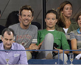 Olivia Wilde watched the 2013 US Open in NYC wearing a green sweater with gray skinny Hudson denim.