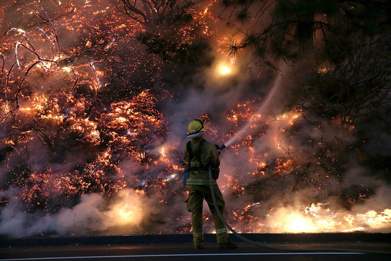 A firefighter battled the flames by Yosemite National Park.