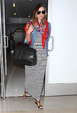 Miranda Kerr punched up LAX in her striped maxi dress, colorful printed scarf, and denim jacket.