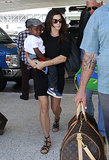 Sandra Bullock showed off a little black dress with strappy gladiator sandals upon arriving at LAX.