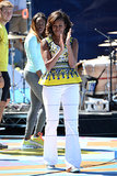 Michelle took the stage at Arthur Ashe Kids' Day in a bright yellow top by Prabal Gurung, which she smartly paired with classic white pants.