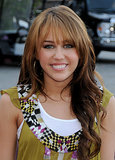 A little more grown-up, a 16-year-old Miley experimented with blunt bangs for a time and began her love affair with black eyeliner.
