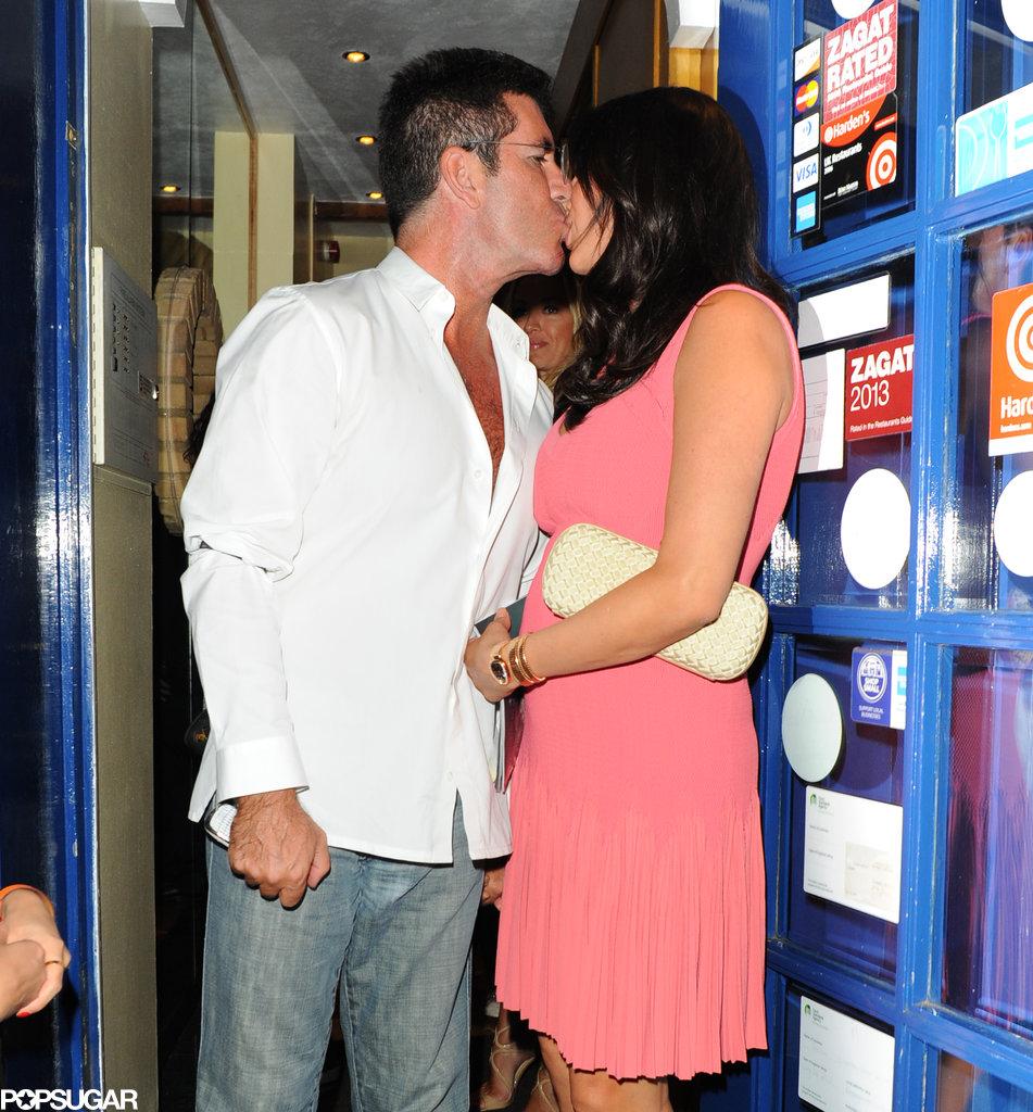 Simon Cowell kissed his pregnant girlfriend, Lauren Silverman.